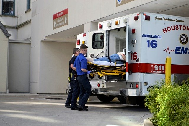 First Responders loading a patient into an ambulance